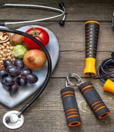 Image of healthy foods, a stethoscope, and other tools in lifestyle medicine.